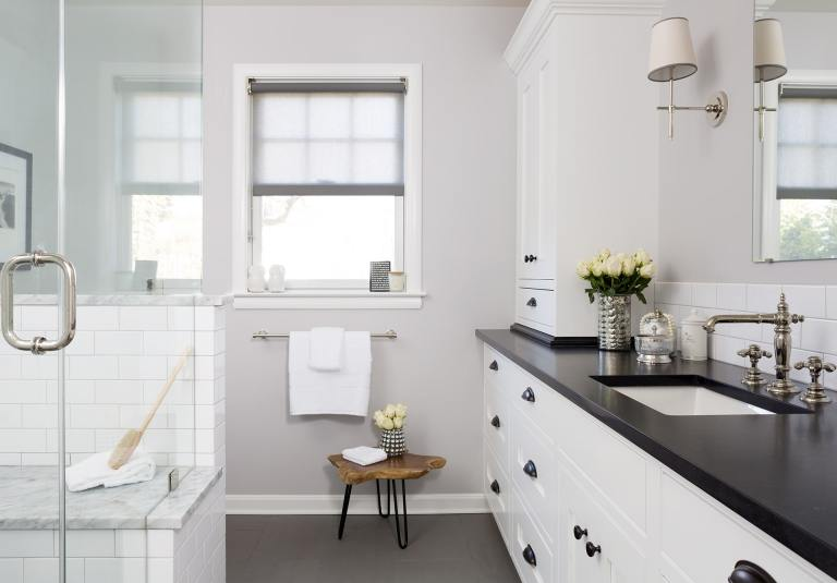 black and white bathroom with plenty of storage separate shower stall with glass walls and built in bench
