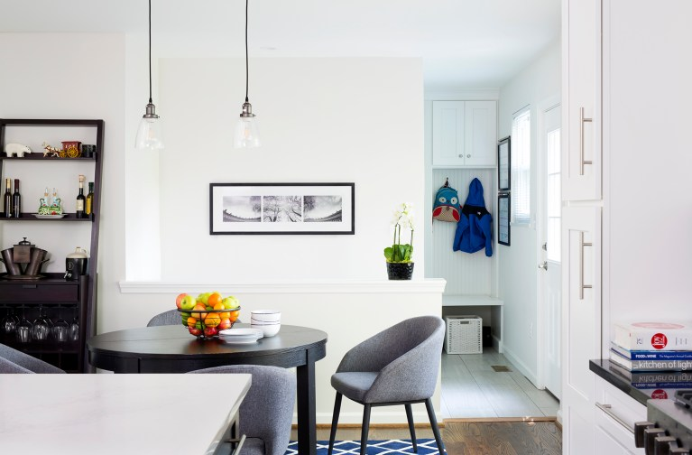 eat in area in kitchen with pendant lighting and view into mudroom