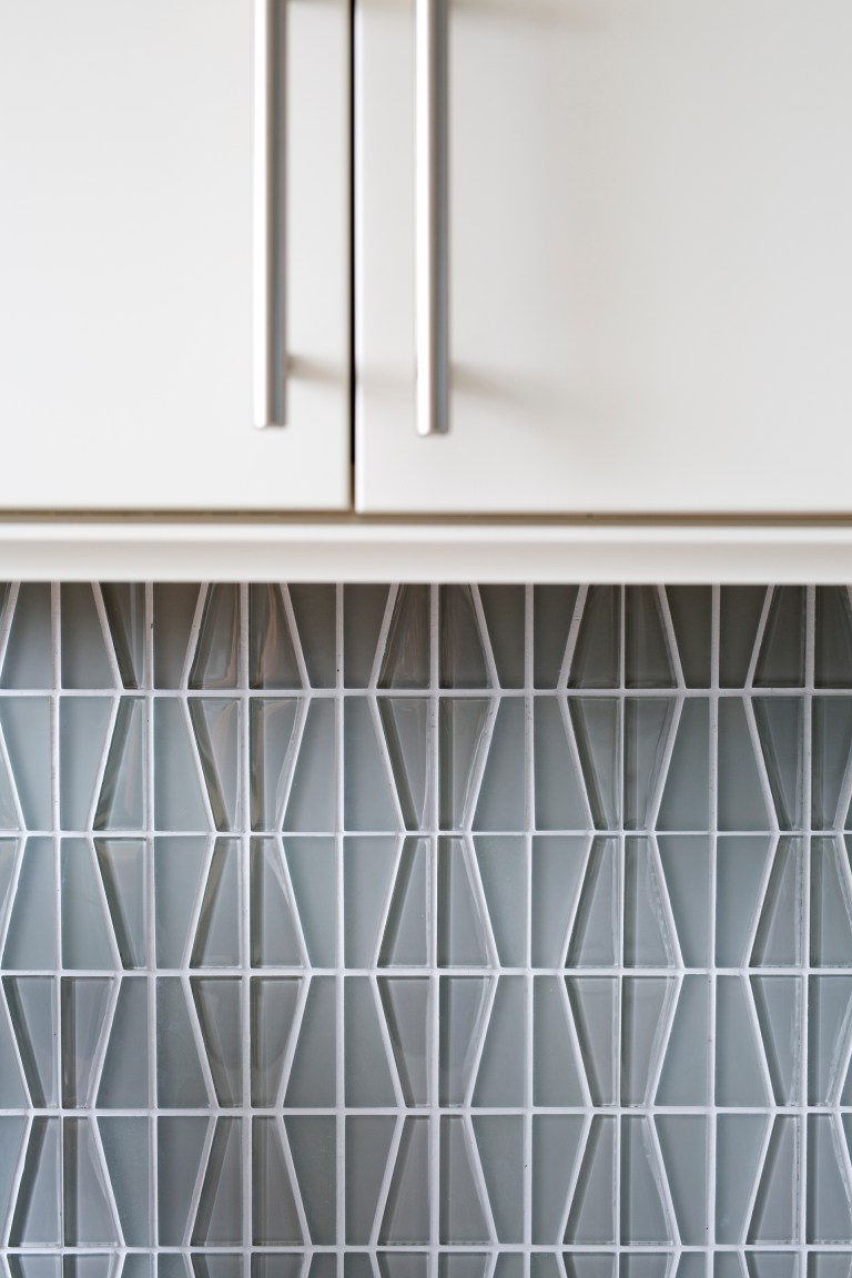 close up of geometric tile kitchen backsplash