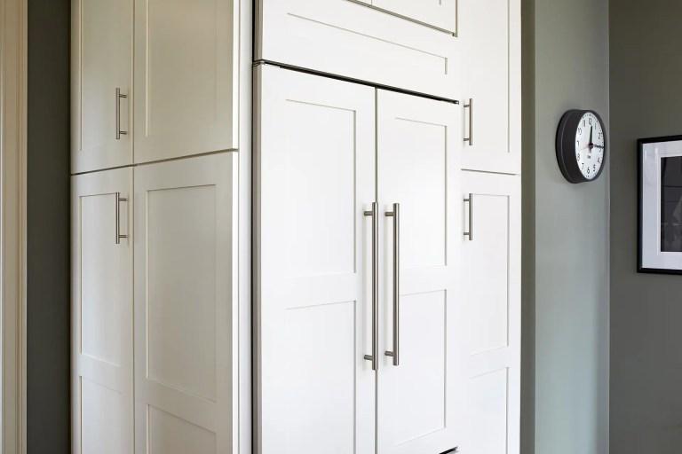 white cabinetry paneled refrigerator