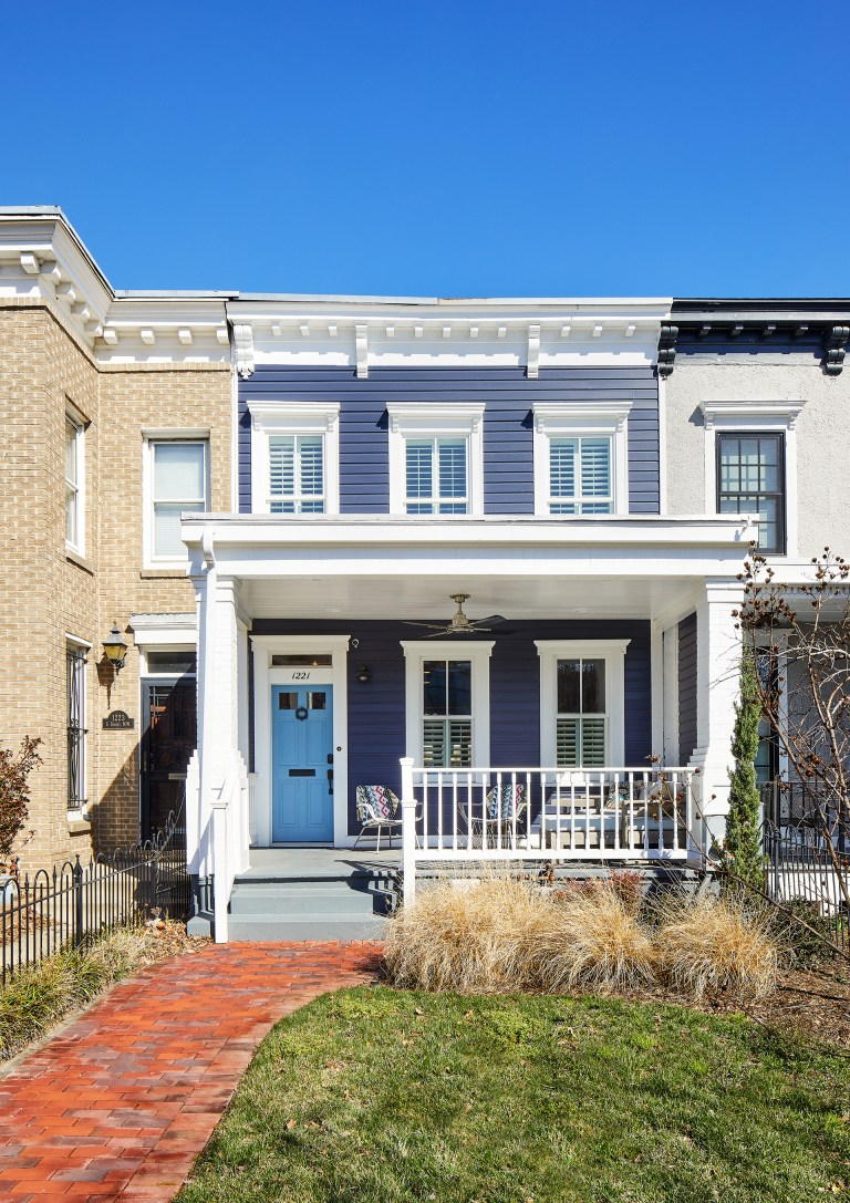 blue DC town home with brick pathway