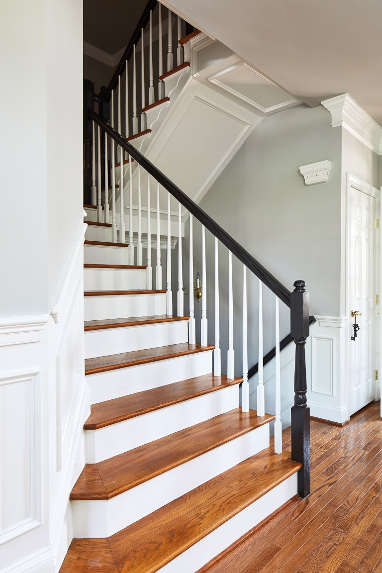 wood curved staircase, wood stairs with black wood bannister