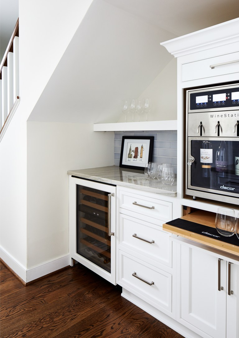 design build northern Virginia kitchen with side bar with white cabinets and subway backsplash with wine station and pull tray