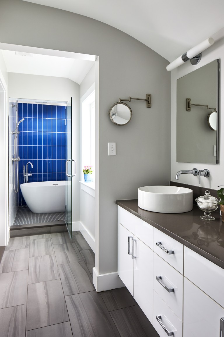 double up bathroom with walk in shower with small soaking tub inside, glass see thru door