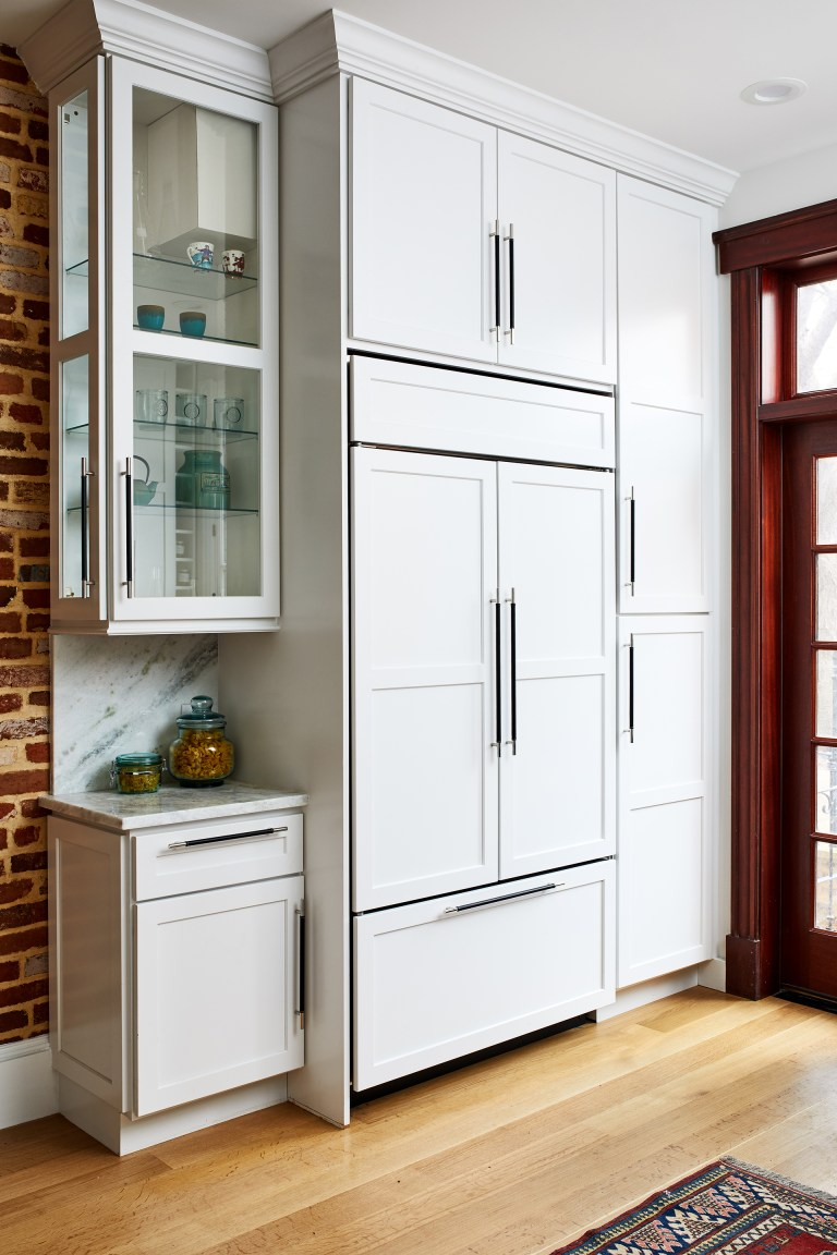 bright white cabinets along with all hardwood floor