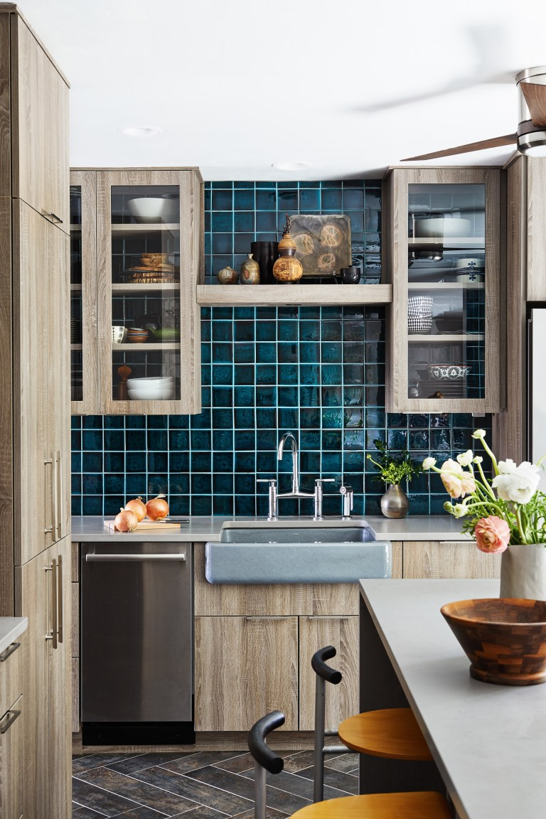 renovated virginia kitchen with natural wood cabinetry and teal tiling