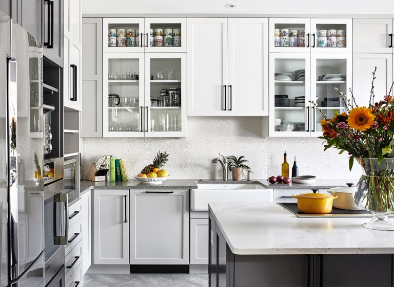 Maryland transitional shades of grey kitchen with white kitchen island top and grey base, white cabinets with black pull handle