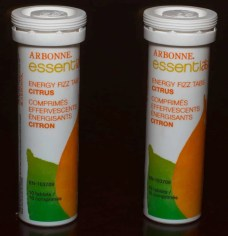 Two containers of the Arbonne Essentials Energy Fizz Tabs Citrus