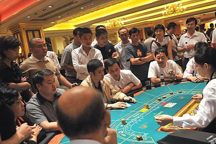Chinese gamblers playing baccarat