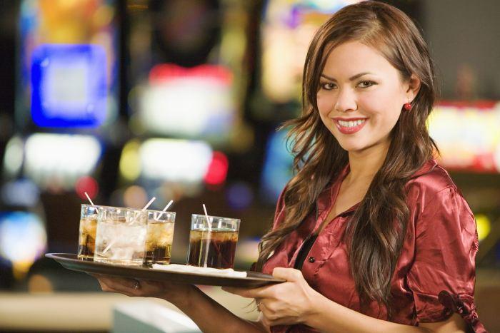 casino waitress with tray of drinks
