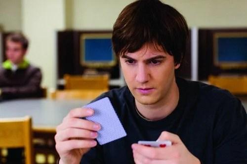 MIT blackjack team member looks at cards