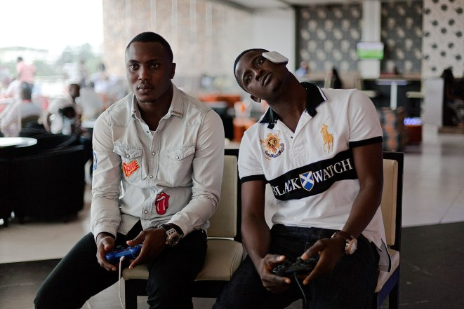 Two guys play console games in Nigeria