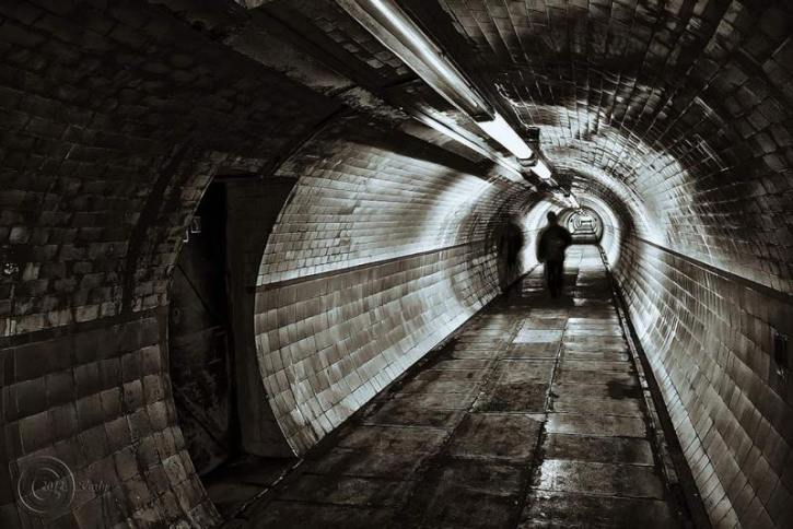 A dark tunnel where people may seek shelter