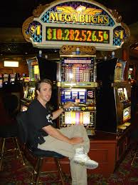 10 Man Playing a progressive Slot Machine
