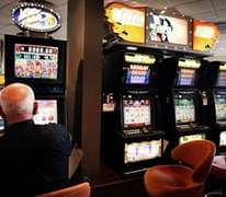 Australia gripped by poker machine addiction, report says