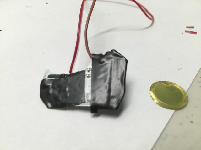 Test pads covered with electrical tape