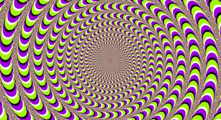 Illustration of several purple, green, white, and black circles; they appear to be moving