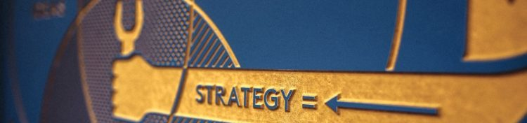 """Gold and blue wall plaque with the word """"strategy"""""""