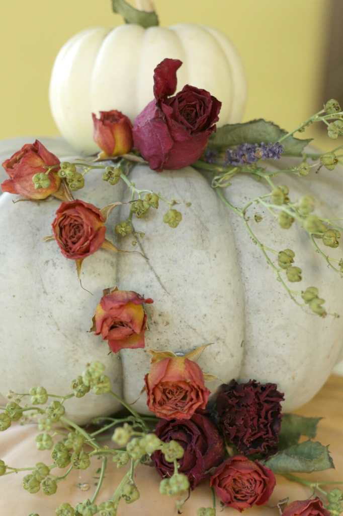 cascading dried flowers on pumpkin display