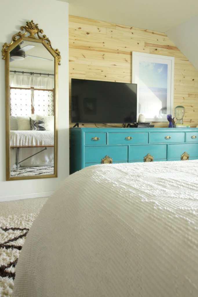 modern-boho-bedroom-gold-mirror-teal-dresser