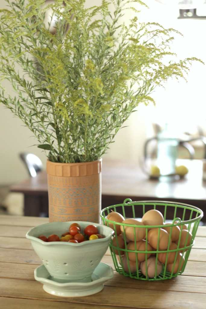 weeds-and-farm-fresh-eggs-tomatoes-as-floral-centerpiece