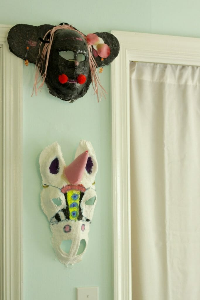 Handmade child's masks in bedroom