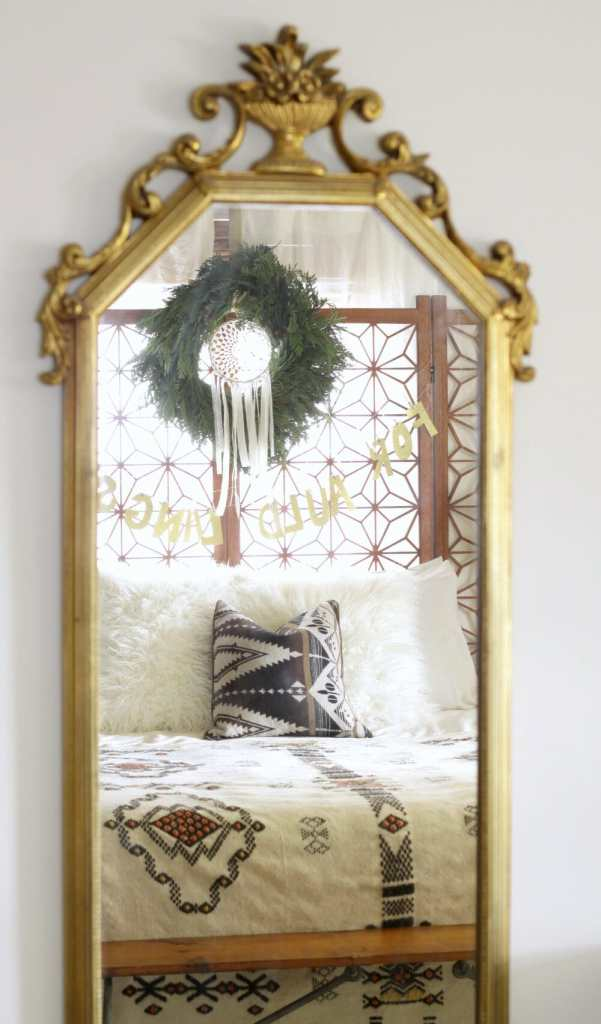 Bedroom reflected in gold mirror