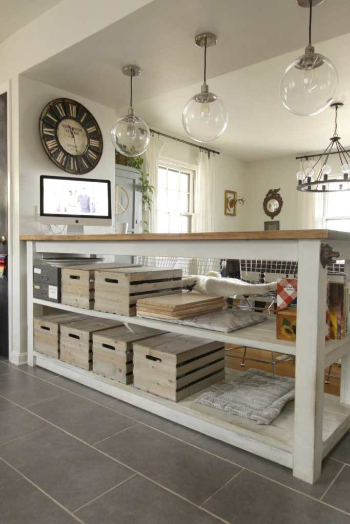 Custom Industrial Kitchen Island with Crates & Pallets crates for storage.