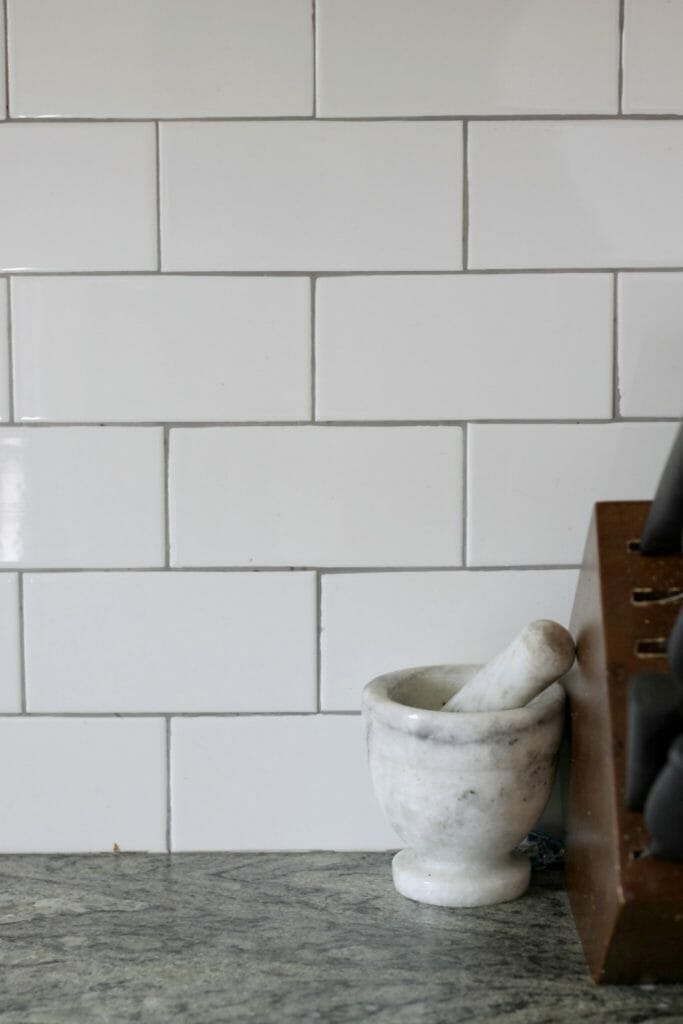 White Subway tile with gray grout backsplash