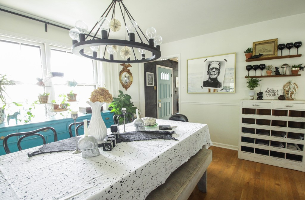 Eclectic Vintage Halloween Dining Room with Frankenstein Poster over art