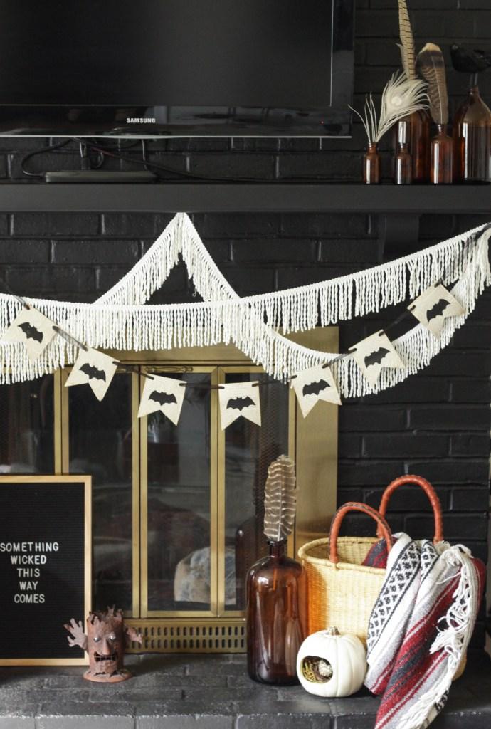 DIY Bat banner on fireplace for Halloween