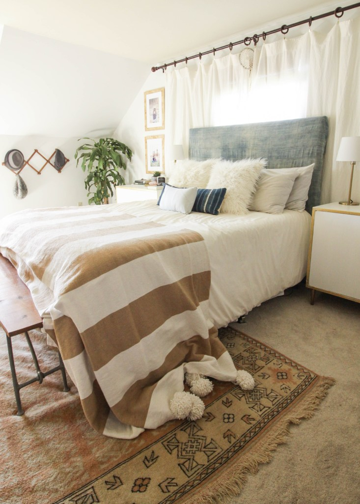 Mix of vintage blue textiles in modern boho bedroom
