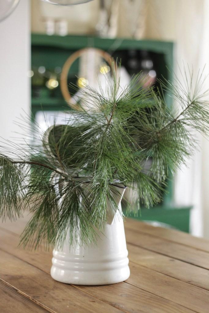 Farmhouse Christmas Decor- vintage enamel pitcher with greenery