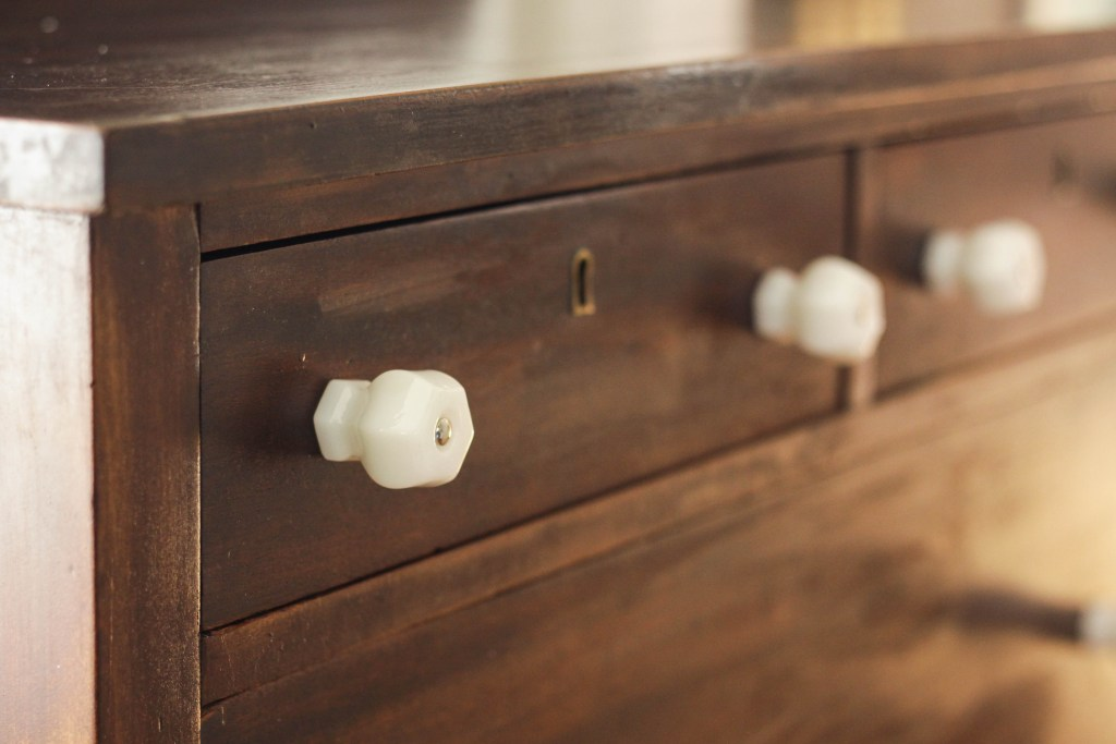 Chunky Milk Glass Knobs Paired with wood Dresser