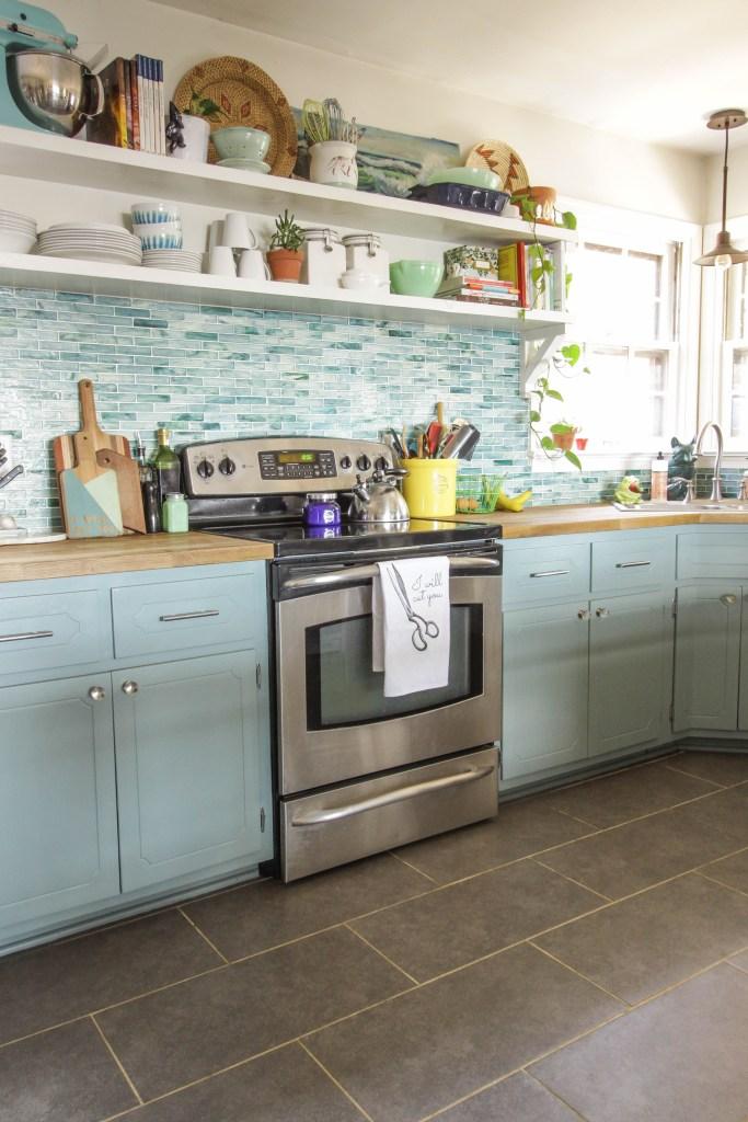 Beautiful aqua kitchen with open shelving