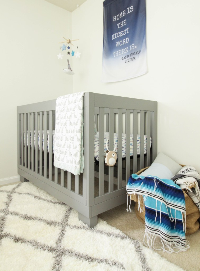 Modern Gray Crib by Babyletto in boys' nursery.