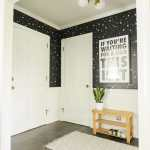 Midcentury rancher small entry with modern lighting in gold