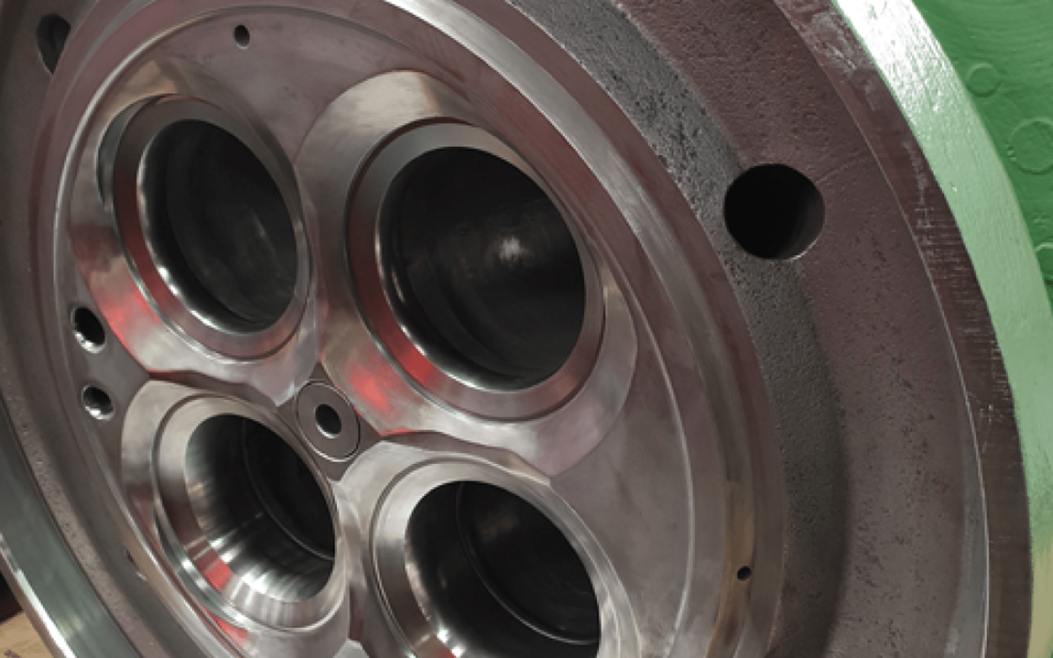 Wartsila Cylinder Head Valve Seat pockets after repair from Cast Iron Welding Services