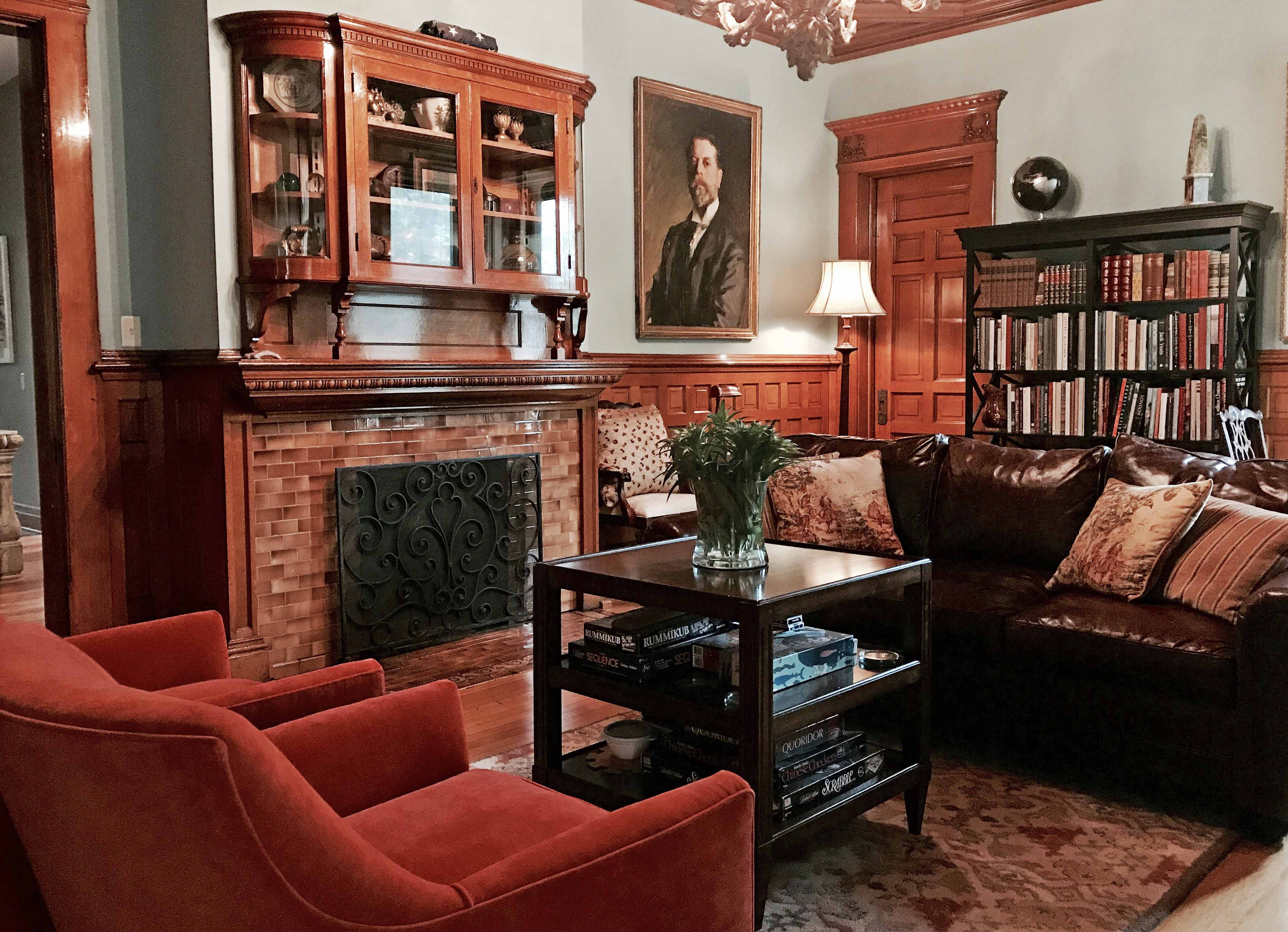 Cozy sofas and inviting fireplace make for a restful evening in The Library at Castle La Crosse Bed and Breakfast.
