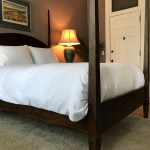 Luxury Bedding and a Cozy 4 Poster Bed Await You in the Oak Suite at Castle La Crosse B&B