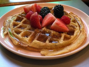 Waffles with warm Maple Syrup and fresh berries. Yum!