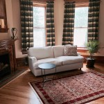 A plush sofa to lounge on in the Walnut Suite at Castle La Crosse Bed and Breakfast