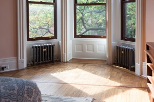 Two-pipe steam radiators in Greek Revival Brownstone
