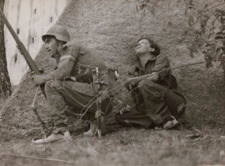 Taro and a soldier take cover in 1936.
