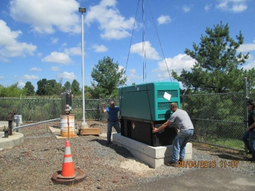 Crane lowering new generator at Pump Station 15 in Buckingham Township, Bucks County, PA