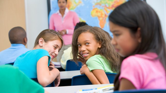 Female pupil being bullied in elementary school image