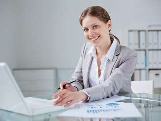 Young businesswoman working in office image