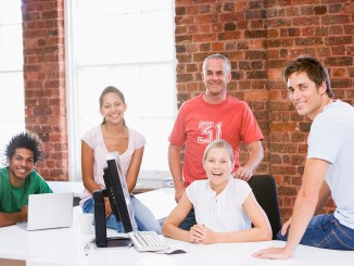 Five businesspeople in office space smiling image