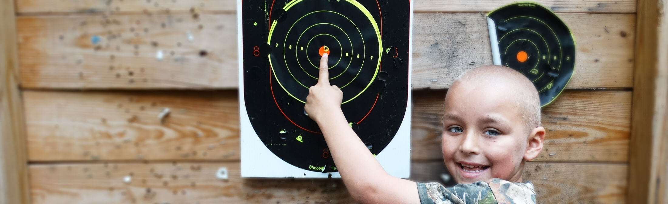 Catch-A-Dream child with bullseye during range time