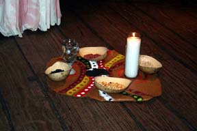 Offering to All our Ancestors, ceremonial art installation by Maria Mar